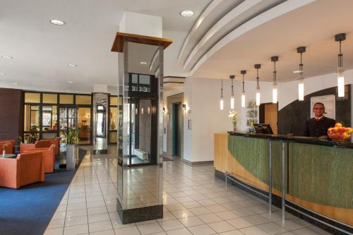 The lobby or reception area at IntercityHotel Freiburg