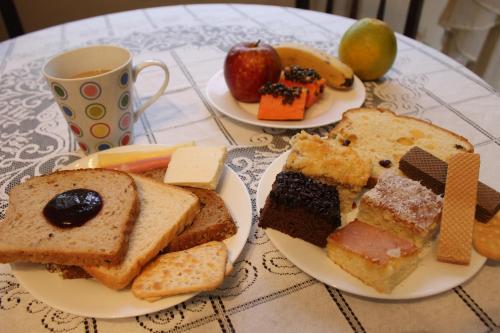 Opções de café da manhã disponíveis para hóspedes em Curitiba Casa Hostel