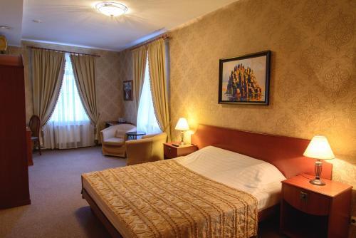 Кровать или кровати в номере Отель Викинг