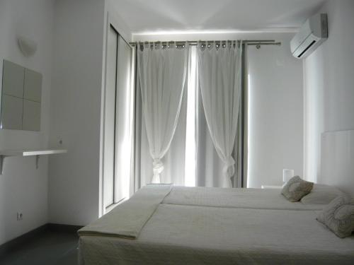 Кровать или кровати в номере KR Hotels - Albufeira Lounge