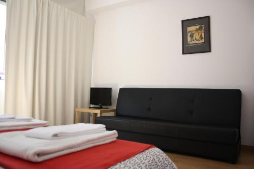 Een bed of bedden in een kamer bij Alegria Rooms