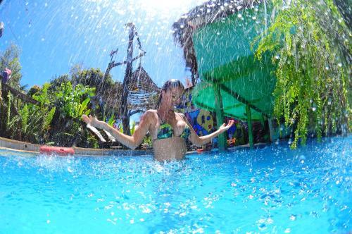 The swimming pool at or near Pousada das Galinhas