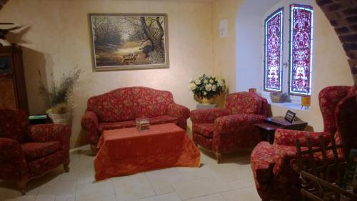 Coin salon dans l'établissement Chambre d'Hotes La Brunetière