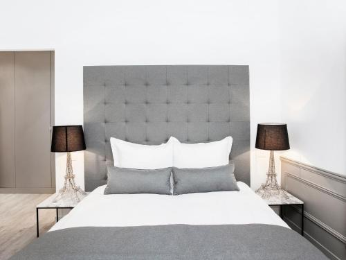 A bed or beds in a room at Luxury 3 Bedrooms Le Marais I by Livinparis