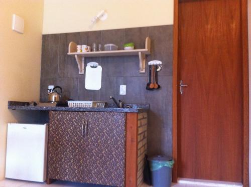 Ванная комната в Nascer Do Sol Suites