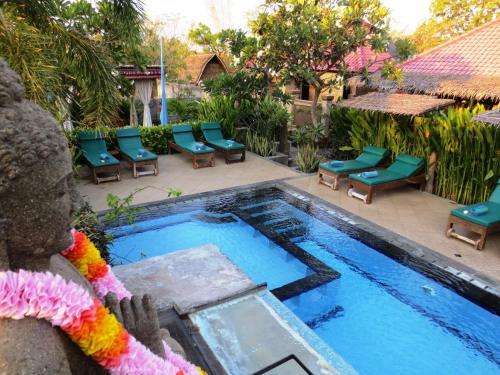 Vista sulla piscina di Taruna Boutique Homestay & Spa o su una piscina nei dintorni