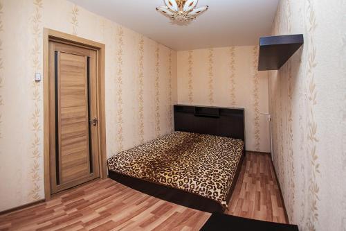 Кровать или кровати в номере NSK-Kvartirka, Apartment Marksa 19
