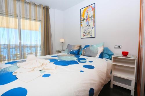Cama o camas de una habitación en Apartamentos La Torre