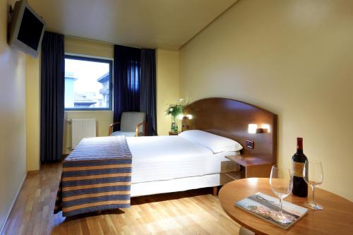 A bed or beds in a room at Exe Hotel El Magistral
