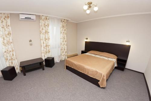 Кровать или кровати в номере Гостинично-Оздоровительный Комплекс Семья