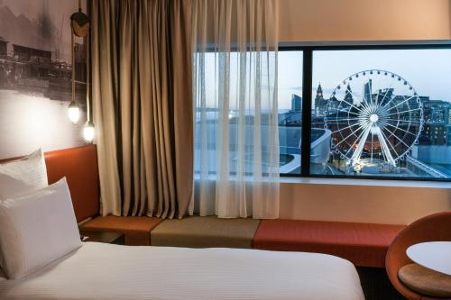 A bed or beds in a room at Pullman Liverpool
