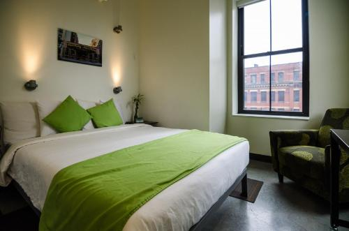 A bed or beds in a room at HI Boston Hostel