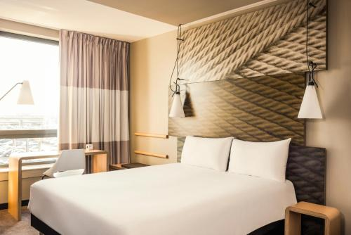 A bed or beds in a room at ibis Paris Coeur d'Orly Airport