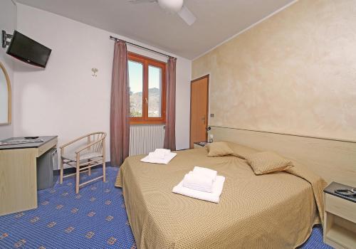Ein Bett oder Betten in einem Zimmer der Unterkunft Garnì Hotel Tignale, GTSGroup