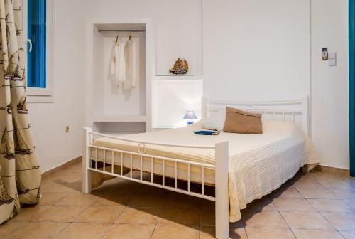 A bed or beds in a room at Seaside Apartments