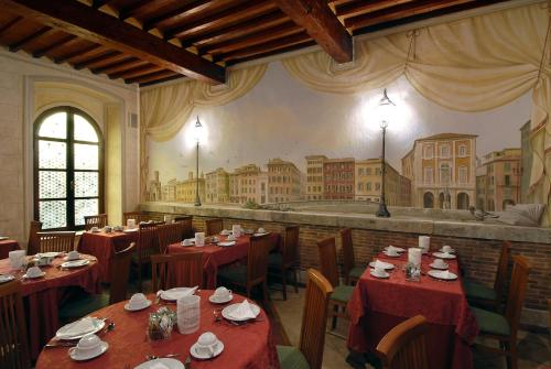 A restaurant or other place to eat at Hotel Bologna
