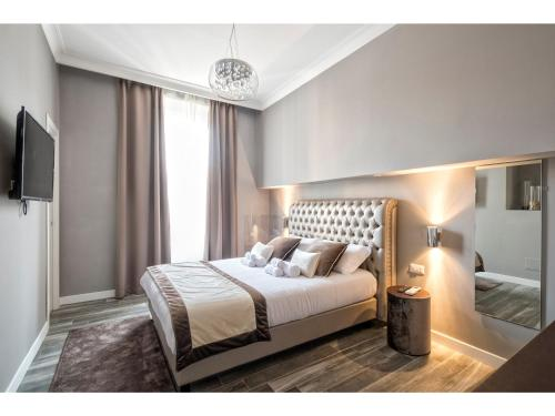 A bed or beds in a room at Lea Luxury Rooms