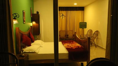 A bed or beds in a room at Tranquil Valley Resort
