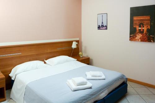 Letto o letti in una camera di Albergo Meublè Abatjour