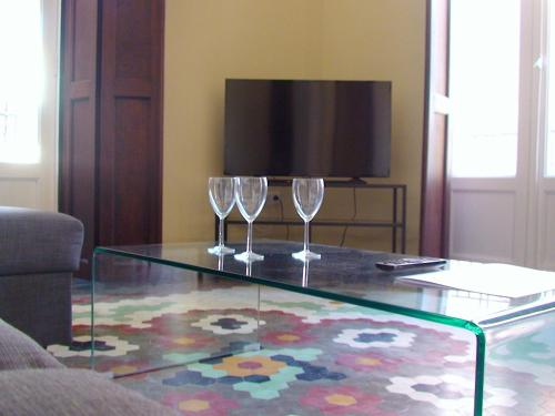 Un televizor și/sau centru de divertisment la Coroa Malvarrosa
