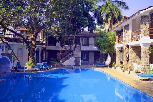The swimming pool at or near The Tamarind Hotel Anjuna