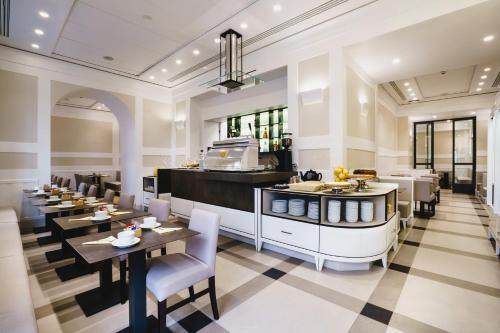 Restaurant ou autre lieu de restauration dans l'établissement Hotel Smeraldo