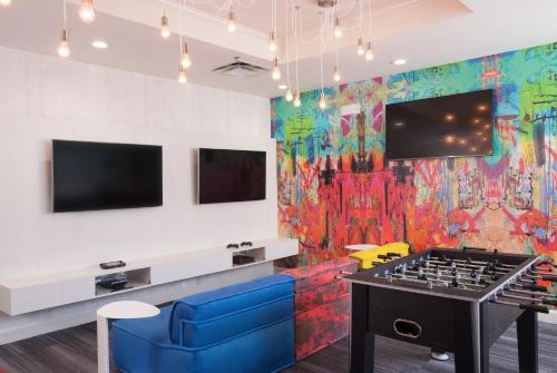 A television and/or entertainment centre at Delta Hotels by Marriott Orlando Lake Buena Vista