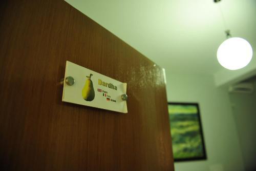 Certificado, premio, señal o documento que está expuesto en Hotel Blini