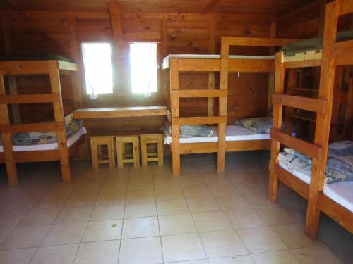 A bunk bed or bunk beds in a room at Sóstói Lovaskemping és Turistaház