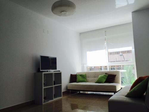 A seating area at Apartamentos Benito Perez