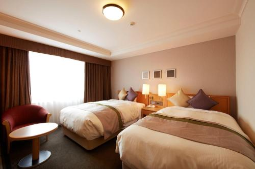 A bed or beds in a room at Keio Plaza Hotel Hachioji