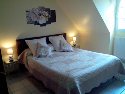 Un ou plusieurs lits dans un hébergement de l'établissement La Bourgade