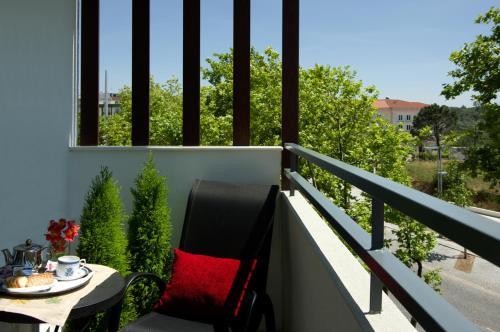 A balcony or terrace at Hotel Lagoa dos Pastorinhos