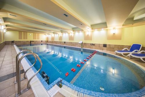 The swimming pool at or near Hotel Murowanica