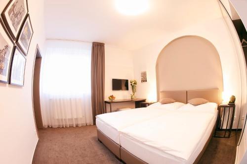 Ein Bett oder Betten in einem Zimmer der Unterkunft Villa na Vinici