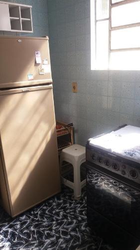 A bed or beds in a room at Apto Temporada na Ilha de Paquetá