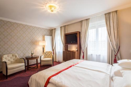 מיטה או מיטות בחדר ב-Hotel Stefanie