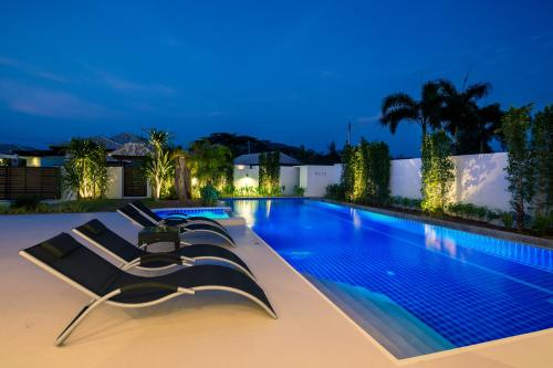The swimming pool at or near Orchid Paradise Homes Villa