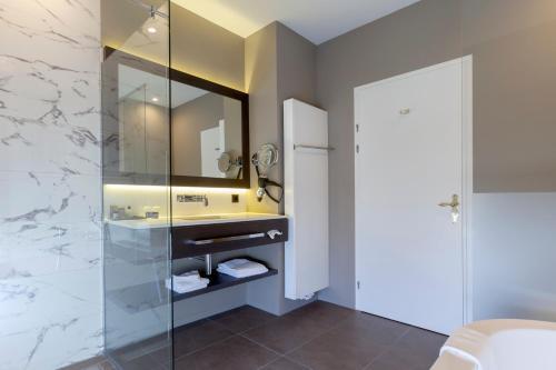 Een badkamer bij Hotel Kasteel Bloemendal