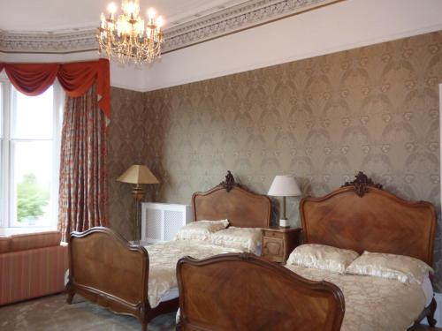 A bed or beds in a room at Moorlands