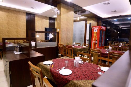 A restaurant or other place to eat at Hotel G-Square - Shirdi