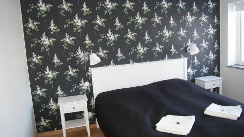 Säng eller sängar i ett rum på Hobykrok B&B