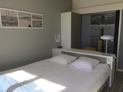 Un ou plusieurs lits dans un hébergement de l'établissement Le Roc Saint Jean