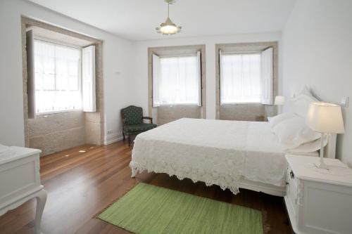 Uma cama ou camas num quarto em Mercearia da Vila