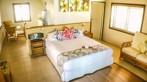 A bed or beds in a room at Muri Beach Resort