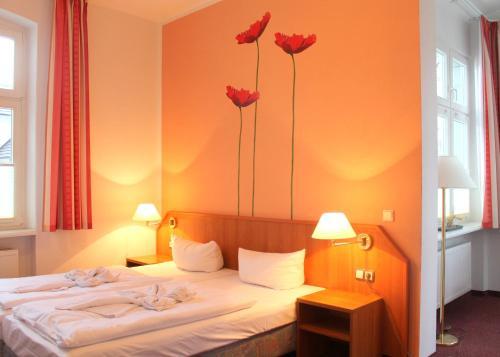 Ein Bett oder Betten in einem Zimmer der Unterkunft Pension Wald und See