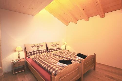 A bed or beds in a room at B&B Panorama
