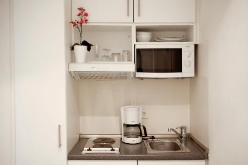 Küche/Küchenzeile in der Unterkunft Hotel Lützow