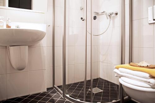 Ein Badezimmer in der Unterkunft Hotel Lützow