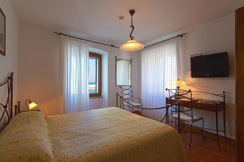 Ein Bett oder Betten in einem Zimmer der Unterkunft Villetta Phasiana
